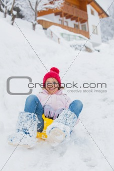 The girl goes for a drive on an snow slope.