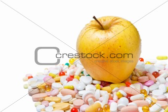 Apple and pills on white background