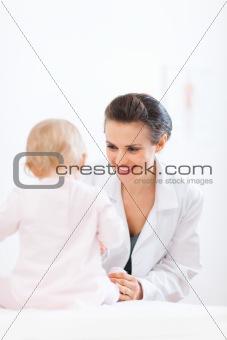 Pediatrician doctor examine baby