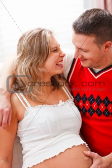 Portrait of happy pregnant woman with husband