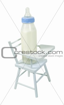 Baby Bottle in a High Chair