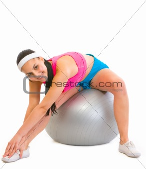 Slim girl making exercises on fitness ball