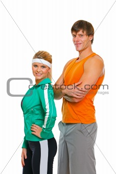 Fitness girl and man in sports wear isolated on white