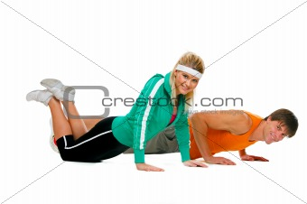 Fitness girl and male athlete making push up exerciser isolated on white
