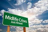 Midlife Crises Just Ahead Green Road Sign with Dramatic Clouds, Sun Rays and Sky.