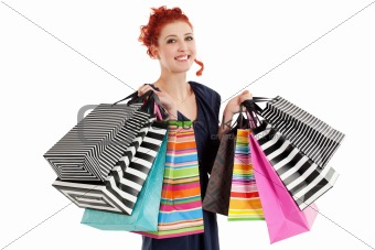 Beautiful woman holding colorful bags