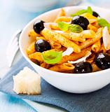 Penne pasta with pesto and olives