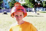 Boy wearing a fireman helmet