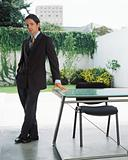 Businessman by desk in garden