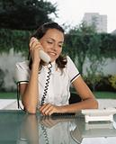 Office worker using telephone
