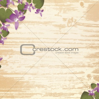 wooden background with violet flowers