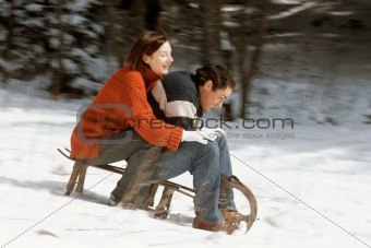 Couple riding a sleigh