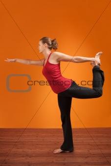 Woman Holds Leg Back
