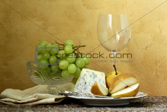 still life glass of wine, blue cheese, green grapes and pears on the table, vintage