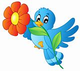 Blue bird carrying flower