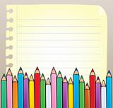 Notepad blank page with crayons