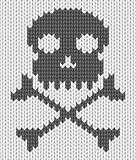 Knitted background with skull