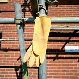 Rubber glove hanging on scaffolding