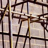 Scaffolding against wall