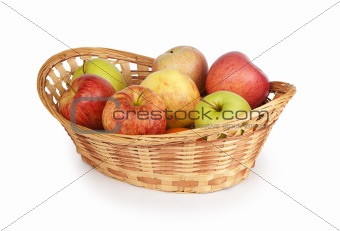 apples in a basket isolated on white
