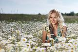 girl on the daisy flowers field