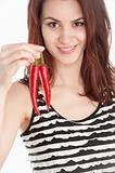 Young woman holding two red chili peppers