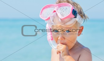A cute little boy wearing a mask for diving
