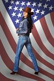 Young woman in jeans with American flag