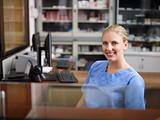 Woman working as nurse at reception desk in clinic