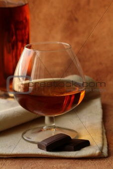 glass of brandy and chocolate pieces