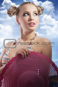 blond woman with summer hat