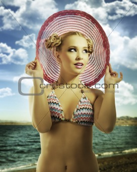 blond girl wearing pink summer hat