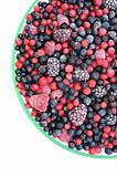 Frozen mixed fruit in bowl - berries - red currant, cranberry, raspberry, blackberry, bilberry, blueberry, black currant