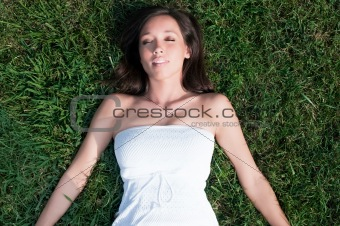Young Woman Laying in Grass