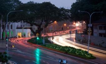 car road lights at sunset