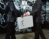 Man and woman exchange a briefcase