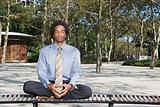 Man meditating in a park