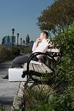 Businessman sleeping on a bench