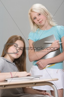 Two girls in a classroom