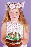 Girl holding a birthday cake