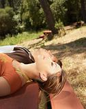 Young couple lying on a picnic table
