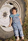 Girl leaning on a tractor tyre
