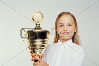 Girl holding a trophy
