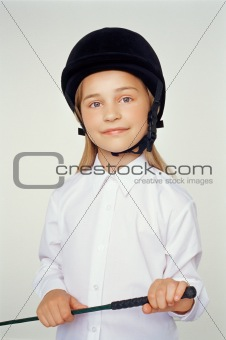 Girl wearing riding hat