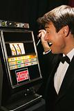 Man playing fruit machine