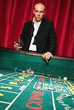 Wealthy man at a craps table