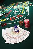 Money and chips on a craps table