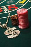 Dollar sign necklace and gambling chips