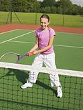 Girl in a tennis court