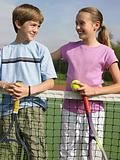 Girl and boy on tennis court
